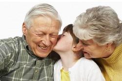 Grandma and Grandpa with grandkid
