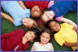Kids laying down in a circle