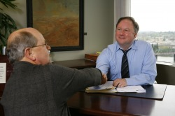 Scott shaking hands with client